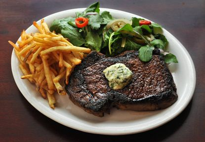 Roseda Ribeye with frites, pickled chile salad and marrow butter at Maggie's Farm, an upscale American comfort food restaurant in Lauraville.