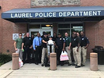 Tyler Carach, 9, stops by the Laurel Police Department on Aug. 4 as part of his six-week journey to give doughnuts to cops across America.