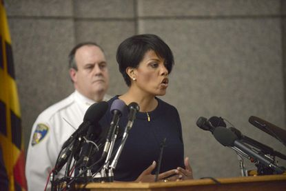 Mayor Stephanie Rawlings-Blake speaks to the media at a press conference on the death of Freddie Gray. Deputy Commissioner Jerry Rodriguez, behind, and Police Commissioner Anthony W. Batts, not shown, also spoke at the conference.