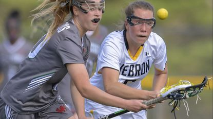 Mt. Hebron's Erin Demek, seen on the right batting to gain control of the ball in the first half of a game against Glenelg Country in April, had a hat trick to lead the Vikings to a 10-5 win over Centennial in a playoff game on Monday, May 14.
