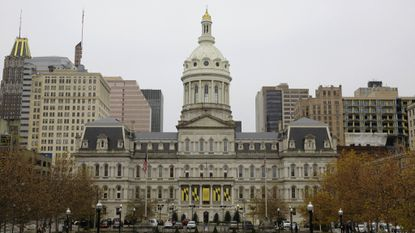 A view of Baltimore City Hall from the steps of the War Memorial Building in Baltimore.