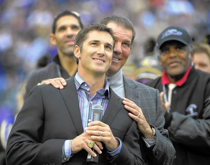 Team owner Steve Bisciotti stands behind Matt Stover, former kicker for the Baltimore Ravens as his name is unveiled during halftime festivities to place his name in the Ravens' Ring of Honor in 2011.