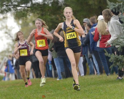 South Carroll junior Grace Siehler leads the pack, followed by Middletown's Erin Mcquitty and Winters Mill's Kathryn Hopkins as they compete in the 2A West Regional Cross Country Championships at Liberty High School Thursday, October 31, 2019. Siehler finished first in the girls race.