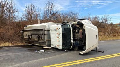 Truck rolls over, spills oil in Mount Airy, police say