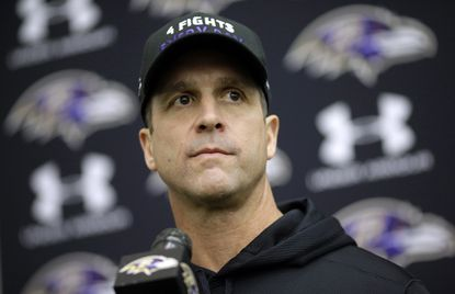 Ravens head coach John Harbaugh speaks at a news conference after football practice, Tuesday, Jan. 6, 2015.