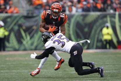 Cincinnati Bengals wide receiver Marvin Jones (82) runs the ball against Baltimore Ravens defensive back Shareece Wright (35) in the first half of an NFL football game, Sunday, Jan. 3, 2016, in Cincinnati. Both Jones and Wright are free agents.