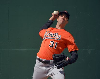 Ubaldo Jimenez throws at the first day of workouts for position players as well as pitchers and catchers last month.