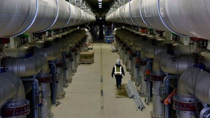 A worker walks through the denitrification building under construction at the Back River Wastewater Treatment Plant.