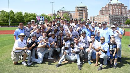 The Johns Hopkins baseball team poses after sweeping Shenandoah on Friday and Saturday at Babb Field in Baltimore in the Super Regional.