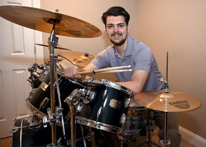 """Kevin Protzman had perfect attendance from kindergarten through high school at St. Mark School and Mount St. Joseph's High School. He played the drums for school plays, the jazz band and the choir and was awarded the Br. Bernardine Ridders, CFX Award for """"the senior who has given the most of himself to make Mount Saint Joseph an exceptional school."""""""