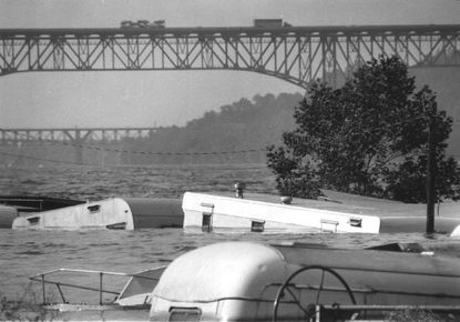 The flooding Susquehanna River inundated trailers below the Interstate 95 bridge near Port Deposit.