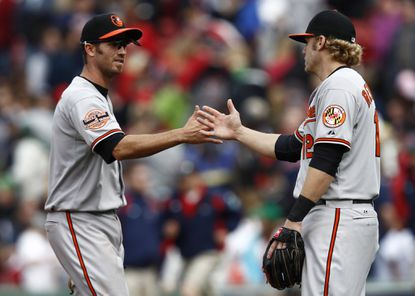 Orioles shortstop J.J. Hardy (left) has lost his card-playing buddy -- and his first baseman -- with Mark Reynolds signing with the Cleveland Indians.