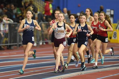 Manchester Valley's Rubie Goffena runs to the outside to take a lead on the field in the 3A girls 3200 meter run, an event she won during the MPSSAA Indoor Track State Championship Meet at Prince George's Sports Complex on Tuesday, Feb. 18.