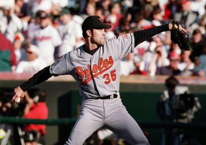 Orioles starter Mike Mussina pitches in the first inning of Game 3 of the ALCS in 1997. Mussina looks to substantially increase his Hall of Fame vote total when balloting is released on Jan. 6, 2016.