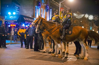 Baltimore mounted Police stand by on the shut-down Charles Street after Ravens fans temporarily got out of hand after watching the Ravens defeat the host Denver Broncos Saturday.