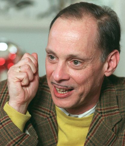 """Writer/ Director John Waters in his Baltimore home. His classic movie """"Pink Flamingos"""" is being re-released."""