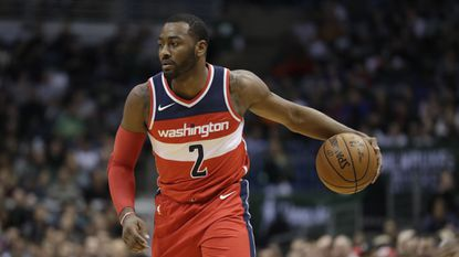 The Wizards' John Wall drives during the first half of agame against the Bucks Monday, Nov. 20, 2017, in Milwaukee.