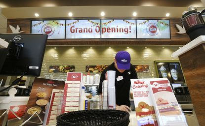 Tyler Heck, a general manager in training, attends to last-minute details at the new Wawa location on Liberty Road in Eldersburg Wednesday, Sept. 25, 2019 ahead of their grand opening Thursday morning.