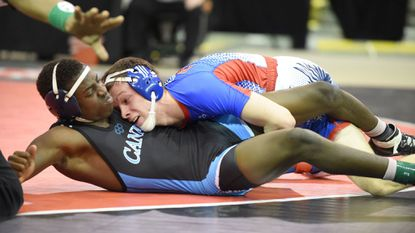 Centennial's Jason Kraisser, right, gets points against Huntingtown's Josh Stokes as he tries for a pin in the championship match of the Class 4A-3A 145-pound weight class during the state wrestling tournament at The Show Place Arena in Upper Marlboro on Monday.