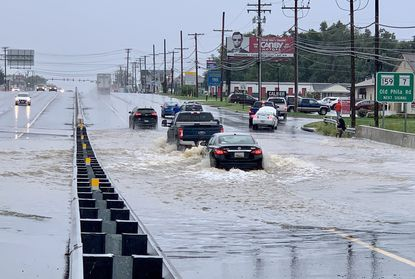 Some drivers carefully navigate the high water as others look to turn back and find another route as a stalled vehicle gets assistance after driving through flooded area of Rt. 40 West between Rt. 7 and Rt. 715 in Aberdeen Thursday September 23, 2021.
