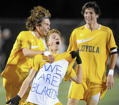 Left to right, Loyola's Nick Battaglia, Sean Clark and Riley Collins celebrate a goal scored by a teammate in the Dons' 2-0 victory over McDonogh in the MIAA A Conference championship.