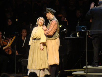 "Kimberly Christie as Hodele and Jason Hentrich as Perchik in the Live Arts Maryland performance of ""Fiddler on the Roof,"" at Maryland Hall."