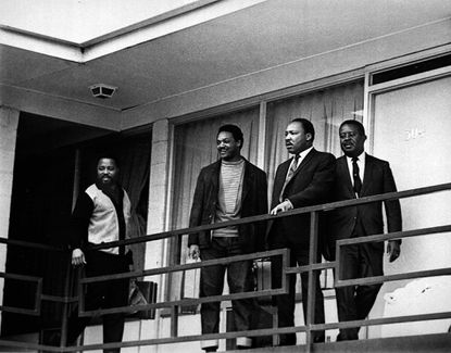 The Rev. Martin Luther King Jr. stands with other civil rights leaders on the balcony of the Lorraine Motel in Memphis, Tenn., on April 3, 1968, a day before he was assassinated at approximately the same place. From left are Hosea Williams, Jesse Jackson, King, and Ralph Abernathy. The 39-year-old Nobel Laureate was the father of non-violence in the 1960s American civil rights movement. King is honored with a national U.S. holiday celebrated in January. (AP Photo) ORG XMIT: APHS132