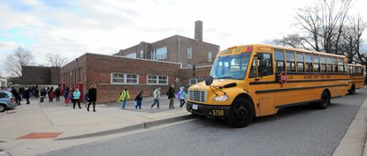 Students board school buses outside Colgate Elementary, which was given the lowest rating of 173 schools in the Baltimore County school system.