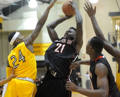 Princeton Day Academy's Anton Waters shoots over St. Frances' Maurice White.