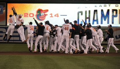 The Orioles celebrate after defeating the Toronto Blue Jays Tuesday, Sept. 16, 2014, as Baltimore wins its first AL East championship pennant at home since 1969.