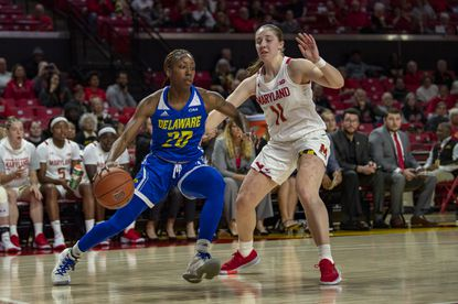 Delaware guard Jasmine Dickey (20) pushes toward the basket as Maryland guard Taylor Mikesell (11) defends during the first half of an NCAA college basketball game, Sunday, Nov. 17, 2019, in College Park, Md. (AP Photo/Brien Aho)