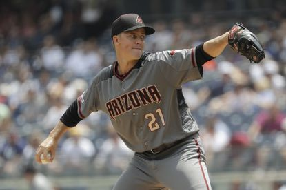 Arizona Diamondbacks' Zack Greinke (21) delivers a pitch during the first inning of a baseball game against the New York Yankees Wednesday, July 31, 2019, in New York. (AP Photo/Frank Franklin II)