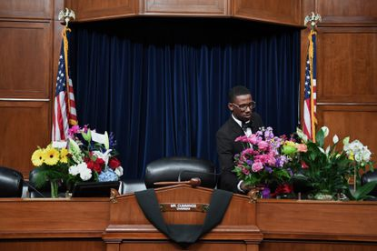 Flowers are put on the desk used by Rep. Elijah Cummings, D-Md., in the chambers for the House Committee on Oversight and Reform where he served as chairman. The Baltimore native died on Thursday, Oct. 17, 2019.