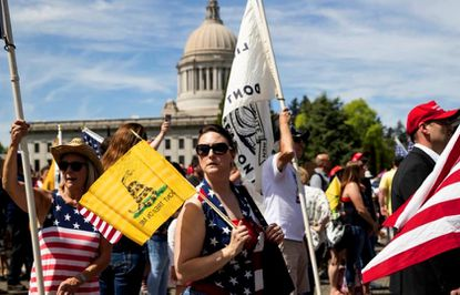 Tammy Snider, of Parkland, Wash. was one of an estimated 1,500 protesters at a rally in Olympia on Saturday against Washington state's stay-at-home order in response to the coronavirus pandemic.