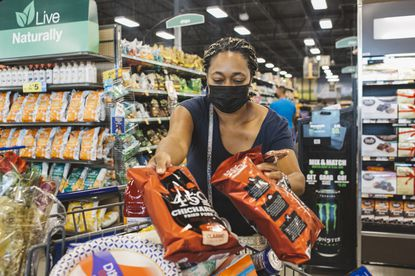 Jennifer Flanigan loads up a cart at a Kroger store in West Chester, Ohio on Sept. 7, 2020. Americans may be tired of dealing with the restrictions that have come with the COVID-19 pandemic but falling temperatures may soon give cause for greater concern.
