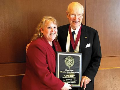 Long Reach High School social studies team leader and 2014-2015 Maryland Teacher of the Year Jody Zepp accepts the National Society of High School Scholars' Educator of the Year award from Claes Nobel, the society's chairman and a member of the family who created the Nobel Prize.
