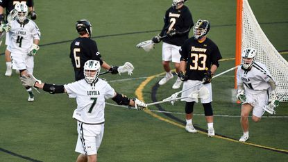 Loyola Maryland junior attackman Pat Spencer (pictured here celebrating after scoring a goal against Towson on Feb. 28) is CBS Sports Network analyst Evan Washburn's choice as the leading candidate for the Tewaaraton Award.