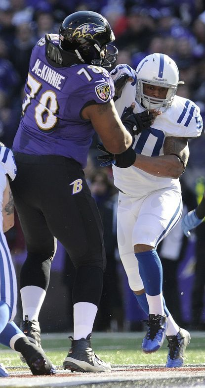 Tackle Bryant McKinnie talks to a teammate during the Ravens' playoff game against the Indianapolis Colts at M&T Bank Stadium in Baltimore Jan. 6.