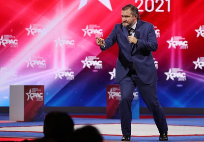 U.S. Sen Ted Cruz (R-Texas) speaks to a cheering crowd at CPAC at the Hyatt Regency in Orlando on Friday, February 26, 2021.(Stephen M. Dowell/Orlando Sentinel)
