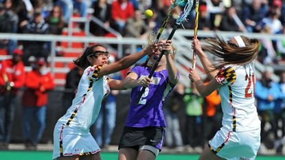 Maryland's Iliana Sanza, left, and Taylor Cummings, right, tried to defend against James Madison's Taylor Gress in the first half of a game in 2013.