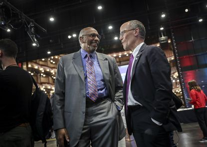 Former Republican National Committee Chairman Michael Steele chats with then-Democratic National Committee chairman Tom Perez in the spin room ahead of the first Democratic presidential primary debate for the 2020 election at the Adrienne Arsht Center for the Performing Arts in Miami, Florida on June 26, 2019. Mr. Perez has declared himself a candidate for Maryland governor in 2022. Mr. Steele may yet join him in the race. Both are from the D.C. suburbs. (Drew Angerer/Getty Images).
