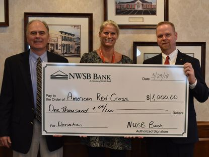Pictured, from left, are ACNB Bank Executive Vice President/Market President of NWSB Bank Tom N. Rasmussen; American Red Cross Western Maryland Chapter Executive Director Beverley Rowe Stambaugh; and NWSB Bank Senior Vice President/Regional Commercial Lending Manager and 2018 Volunteer of the Year Andrew P. Heck. - Original Credit: Courtesy Photo