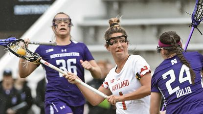 Maryland's Brindi Griffin winds up to shoot past Northwestern's Ivy Arlia in the Terps' 16-11 loss in the Big Ten championship game Saturday.