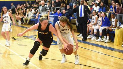 South Carroll's Ashleigh Zepp, left, and Liberty's Rachel Thiem battle for a possession of the ball during a girls basketball game at Liberty High School on Thursday, Dec 20.