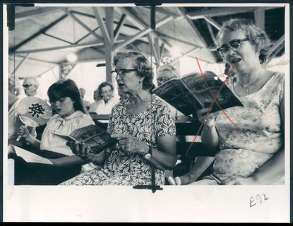 Folks in Emory Grove take part in religious services in the Tabernacle in July of 1980.