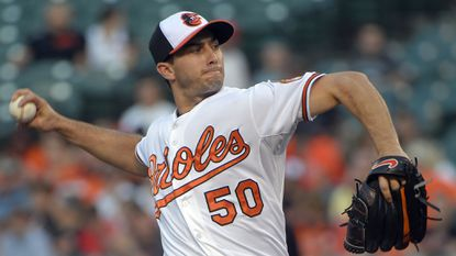 Orioles starting pitcher Miguel Gonzalez delivers against the Seattle Mariners at Camden Yards.