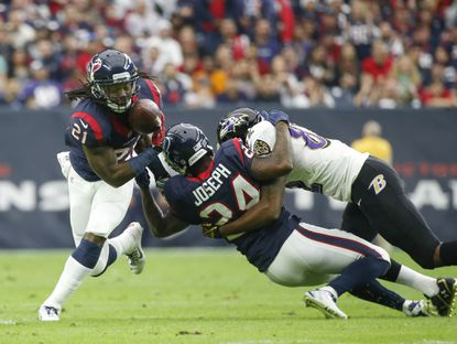Former Texans free safety Kendrick Lewis cannot make an interception during the first half against the Ravens last season.