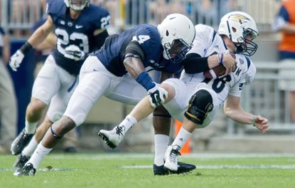 Penn State's Adrian Amos (4) takes down Akron's ball carrier during the Sept. 6 game.