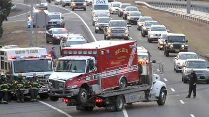 A fire department vehicle from Bel Air, MD, is pulled out of the woods after it was invoved in a collision with a car that overturned on Route 195 Eastbound at Exit 22 in Jackson Wednesday afternoon, February 14, 2018.