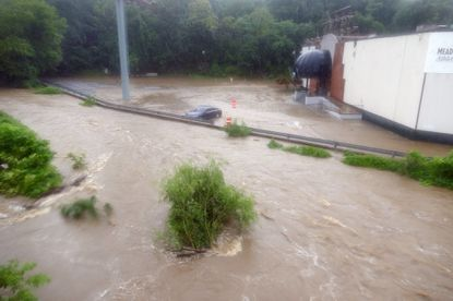 Flooding along the Jones Falls at Meadow Mill during one of the July storms that resulted in an overflow of sewage-tainted stormwater from the city's decrepit sewer system.